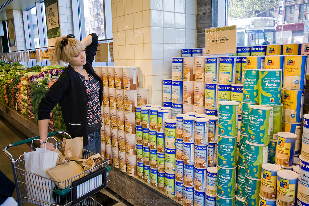 Mariel Booth, a professional model and New York University student, shops for protein powder from a Whole Foods near her apartment in New York city. (Mariel Booth is featured in the book What I Eat: Around the World in 80 Diets.) The caloric value of her day's worth of food on a day in the month of October was 2400 kcals.  At a healthier weight than when modeling full-time, she feels good but laments that she's making much less money. MODEL RELEASED.