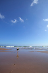 Girl running walking beach waves lunan bay summer