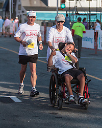 Falmouth Road Race early start for disabled participant