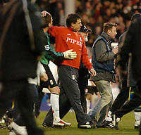 Photo: Ed Godden.<br /> Fulham v Chelsea. The Barclays Premiership. 19/03/2006.<br /> Chris Coleman, Fulham manager, leaves the pitch at full-time.