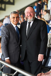 © Licensed to London News Pictures. 8/05/2016. London, UK. London's newly elected mayor, Sadiq Khan and Chief Rabbi, Ephraim Mirvis at 'Yom Hashoah' the UK Jewish communities national holocaust remembrance commemoration at Barnet Copthall Stadium, north west London.Photo credit: Simon Jacobs/LNP