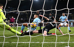 Manchester City's Nicolas Otamendi (left) scores his side's first goal of the game during the Premier League match at the Etihad Stadium, Manchester.