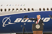 U.S. President Donald Trump standing in front of the new Boeing 787-10 Dreamliner aircraft points to Air Force One during his address to employees at the Boeing factory February 17, 2016 in North Charleston, SC. The visit comes two days after workers at the South Carolina plant voted to reject union representation in a state where Trump won handily.