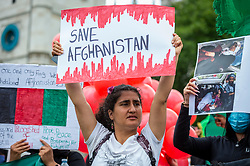 © Licensed to London News Pictures. 18/08/2021. LONDON, UK.  A female member of the British Afghan community protests in Parliament Square in reaction to the Taliban takeover of Afghanistan.  Parliament has been recalled early for Boris Johnson, Prime Minister, and MPs to debate the UK government's decision to bring 20,000 vulnerable Afghan refugees, particularly women and children, to the country..  Photo credit: Stephen Chung/LNP