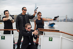© licensed to London News Pictures. London, UK 22/08/2013. City Cruises launching their new Thamesjet, jet powered RIB, speedboat ride service with Tom Cruise, Arnold Schwarzenegger, Angelina Jolie and Daniel Craig lookalikes on Thursday, 22 August 2013 in central London. Photo credit: Tolga Akmen/LNP