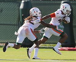 August 1, 2017 - Coral Gables, FL, USA - UM's Daniel Feruson-McAllister (46) breaks away from Sheldrick Redwine (22) during a drill at the University of Miami's first day of football practice for the 2017 season on Tuesday, Aug. 1, 2017 in Miami, Fla. (Credit Image: © Charles Trainor Jr/TNS via ZUMA Wire)