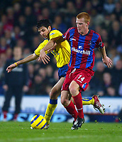 Fotball<br /> Foto: BPI/Digitalsport<br /> NORWAY ONLY<br /> <br /> Crystal Palace v Arsenal<br /> <br /> FA Barclays Premiership. 06/10/2004.<br /> <br /> Francesc Fabregas of Arsenal (L) battles with Ben Watson