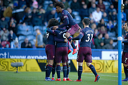 Arsenal's Alex Iwobi jumps on his team mates as Arsenal's Alexandre Lacazette celebrates scoring his side's second goal of the game
