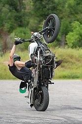 Unknown Industries stunt performers in Sturgis City Park during the 75th Annual Sturgis Black Hills Motorcycle Rally.  SD, USA.  August 7, 2015.  Photography ©2015 Michael Lichter.
