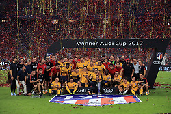Atletico Madrid players celebrate winning the 2017 Audi Cup