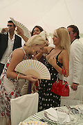 Ellie Shepherd and Marissa Montgomery, Cartier International Polo. Guards Polo Club. Windsor Great Park. 30 July 2006. ONE TIME USE ONLY - DO NOT ARCHIVE  © Copyright Photograph by Dafydd Jones 66 Stockwell Park Rd. London SW9 0DA Tel 020 7733 0108 www.dafjones.com