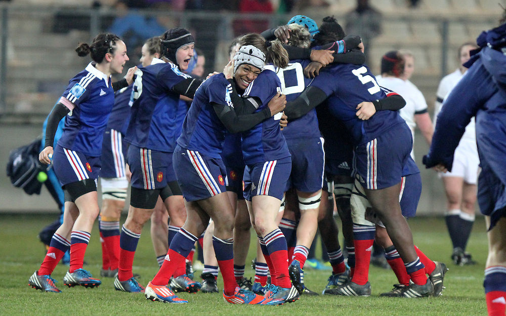 Sandrine Agricole and rest of the French team celebrate victory. France Women v England Women in the Six Nations 2014 at Stade des Alpes, Grenoble, France on Saturday 1st February 2014, kick off 2055