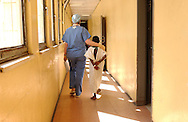 ADDIS ABABA, ETHIOPIA.  Anesthesiologist Dr. Martina Healy (left) of Ireland walks a child to the operating theatre at the Black Lion Hospital in Addis Ababa, Ethiopia on Tuesday, December 6, 2005. An international volunteer medical team with Operation Smile were in Ethiopia's capital city volunteering their time during Operation Smile's inaugural mission to Ethiopia. Operation Smile is the Norfolk, VA based medical organization that provides free facial reconstructive surgery to children and young adults in 24 countries.