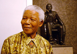 MANDELA D 33 STANDS NEAR A STATUE OF CECIL JOHN RHODES AT THE HANDOVER OF A BUILDING DONATED TO THE MANDELA RHODES FOUNDATION BY DE BEERS IN ST GEORGES MALL PICTURE ROGAN WARD 25 08 03