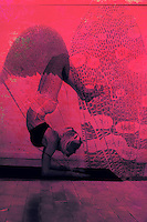 Deep Magenta surreal photo illustration of butterfly textures and shadow silhouette yoga woman in deep inversion arm balance pose.