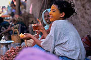 A woman drinking tea in the christian market  outside Harar, the fourth holiest city in Islam,  Situated in Eastern Ethiopia it is considered to be the fourth  holiest city in Islam with 82 mosques. It is a major commercial centre linked by trade routes with the rest of Ethiopia and the entire Horn of Africa.  Ethiopia