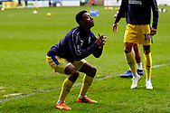 Wimbledon defender Paul Kalambayi (30) warming up  during the EFL Sky Bet League 1 match between Coventry City and AFC Wimbledon at the Ricoh Arena, Coventry, England on 12 January 2019.