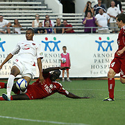 Orlando City Lions Forward Maxwell Griffin (11) gets tackled by Richmond Defender Yomby William (2) during a United Soccer League Pro soccer match between the Richmond Kickers and the Orlando City Lions at the Florida Citrus Bowl on May 25, 2011 in Orlando, Florida.  (AP Photo/Alex Menendez)