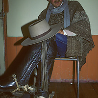 A Chilean huaso (cowboy) relaxes in his home in Cochrane, a village in Patagonia.