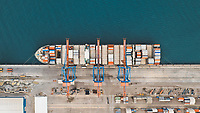 Aerial view of beatifully abstract container ship being loaded at Malaga Port, Spain