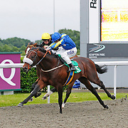 Interior Minister and Ryan Moore winning the 8.10 race