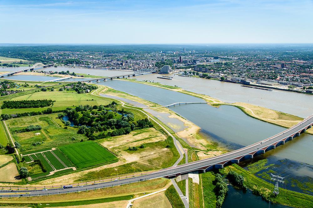 Nederland, Gelderland, Nijmegen, 09-06-2016; de nieuw aangelegde nevengeul van de rivier de Waal, ontstaan door de dijkverlegging bij Lent. Onderdeel van het project Ruimte voor de River (Ruimte voor de Waal). In de voorgrond de oprit naar de brig De Oversteek (buiten beeld). Over het midden van de geul de brug voor wandelaars en voetgangers, De Zaligebrug (Citadelbrug)<br />  The finished dike relocation of Lent (project Ruimte voor de Rivier: Room for the River) with the resulting flood trench. In the foreground new city bridges of Nijmegen.<br /> <br /> luchtfoto (toeslag op standard tarieven);<br /> aerial photo (additional fee required);<br /> copyright foto/photo Siebe Swart