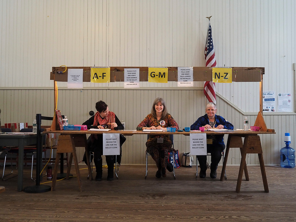 Pollworkers in the Sanbornton, New Hampshire Old Town Hall await voters.