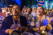 12 MAY 2014 - BANGKOK, THAILAND: Anti-government protestors listen to Suthep Thaugsuban in front of the Parliament. Several thousand protestors with the People's Democratic Reform Committee (PDRC) blocked access to the Thai Parliament building in Bangkok as a part of their continuing anti-government protests. The Parliament is not currently in session and was dissolved by former Prime Minister Yingluck Shinawatra but the Senate is in session. The protestors are demanding that the Senate dissolve the current Pheu Thai caretaker government and appoint a new Prime Minister and cabinet. Members of the Senate leadership met with Suthep Thaugsuban Monday to discuss the impasse.   PHOTO BY JACK KURTZ