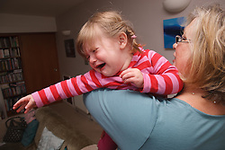 Grandmother holding crying toddler