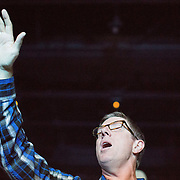 An associate pastor worships during service at the Elevation Church Blakeney Campus.