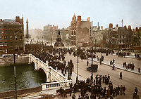 O'Connell Bridge and Sackville (O'Connell) St, showing the aftermath of the 1916 Rising. (Part of the Independent Newspapers Ireland/NLI Collection) Colourised by Tom Marshall (PhotograFix).