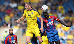 Oxford United's Cameron Norman (left) and Crystal Palace's Mamadou Sakho battle for the ball during a pre season friendly match at The Kassam Stadium, Oxford.