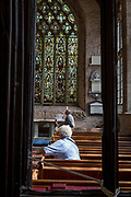 Visitors in the nave of the church of  St. Laurence, Ludlow, on 11th September 2018, in Ludlow, Shropshire, England UK.