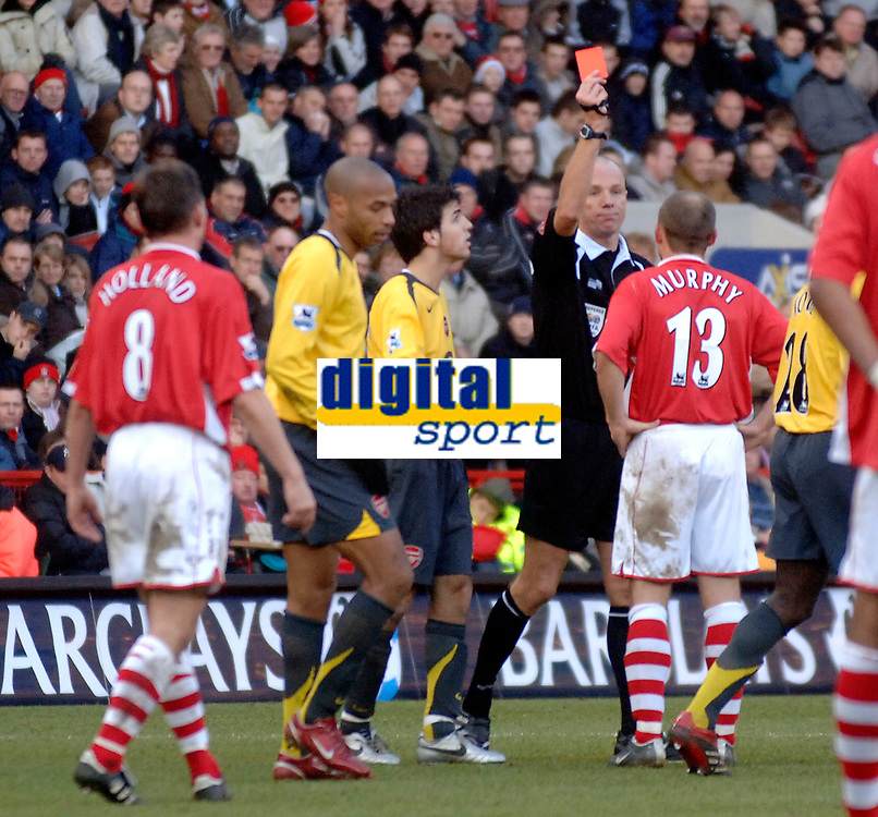 Photo: Glyn Thomas.<br />Charlton Athletic v Arsenal. The Barclays Premiership.<br />26/12/2005.<br /> Charlton's Danny Murphy (R) is shown the yellow card by referee Steve Bennett.