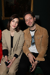 Alexa Chung and Derek Blasberg on the front row during the Erdem Autumn/Winter 2019 London Fashion Week show at The National Portrait Gallery, London.