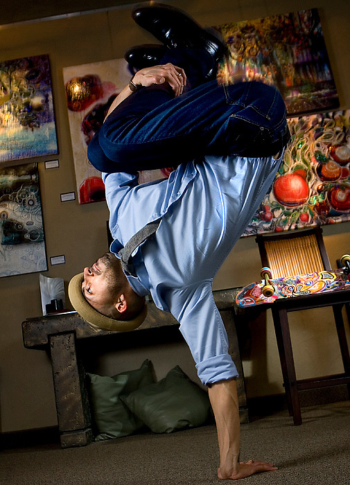 """Pedro Valdivia shows off some of his breakdancing skills in the gallery at You & I Framing & Gallery in Kennewick. """"Dance captures the electric energy of the body and making art is the extension of the mind -- where the heart and hand connect."""""""