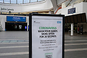 HM Government, and NHS advertising boards advise regular hand washing to help prevent Coronavirus contamination in Grand Central Station in Birmingham city centre is virtually deserted due to the Coronavirus outbreak on 31st March 2020 in Birmingham, England, United Kingdom. Following government advice most people are staying at home leaving the streets quiet, empty and eerie. Coronavirus or Covid-19 is a new respiratory illness that has not previously been seen in humans. While much or Europe has been placed into lockdown, the UK government has announced more stringent rules as part of their long term strategy, and in particular social distancing.
