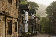 Nag's Head pub at start of Penine Way in Vale of Edale, Peak District National Park, Derbyshire. .Edale is a valley in North Derbyshire, situated about 15 miles west of Sheffield, in the heart of the Peak District National Park. Edale valley is a loose collection of scattered farmsteads or 'booths' as they are known which grew up around the original shelters or 'boothies' used by shepards when tending their sheep on the hillsides. There are 5 main ones in Edale valley, Nether Booth, Ollerbooth, Upper Booth, Barber booth and Grindsbrook Booth of which the village called Edale is part. Edale village is in a lovely setting below Kinder Scout and is the start of the Pennine way, the first and longest footpath in England, opened in 1965.