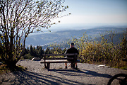 """A visitor is practising """"social distance"""" at the Großer Feldberg (""""Great Field Mountain"""") which is at a height of 879.5 metres, the highest elevation of the Taunus mountains, and of the entire Rhenish Massif. It is situated in the Hochtaunuskreis district in Hessen, Germany."""