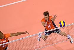 20150620 NED: World League Nederland - Portugal, Groningen<br /> De Nederlandse volleyballers hebben in de World League het vierde duel met Portugal verloren. Na twee uitzeges en de 3-0 winst van vrijdag boog de ploeg van bondscoach Gido Vermeulen zaterdag in Groningen met 3-2 voor de Portugezen: (25-15, 21-25, 23-25, 25-21, 11-15) / Nimir Abdelaziz #1, Bas Van Bemmelen #8