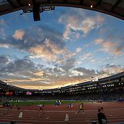 Hampden Park at sunset. Runners in the Decathlon Heats.