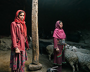 Wakhi women at the return of the herds in the evening. <br /> The traditional life of the Wakhi people, in the Wakhan corridor, amongst the Pamir mountains.