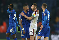 Leicester City's Danny Simpson (second left) and Burnley's Phil Bardsley greet each other after the game