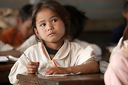 Nang Paysaung 7 years old in class in a school where AusAid has funded training for minority group teachers, Ban Dakduang, Dakcheung, near Sekong, Lao PDR