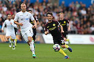 David Silva of Manchester city © goes past Mike van der Hoorn of Swansea city (l).Premier league match, Swansea city v Manchester city at the Liberty Stadium in Swansea, South Wales on Saturday 24th September 2016.<br /> pic by Andrew Orchard, Andrew Orchard sports photography.
