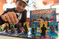 "© Licensed to London News Pictures. 14/11/2018. LONDON, UK. Ashton, aged 12, plays Monopoly Fortnite Edition. Preview of ""DreamToys"", the official toys and games Christmas Preview, held at St Mary's church in Marylebone.  Recognised as the countdown to Christmas, the Toy Retailer's Association, an independent panel of leading UK toy retailers, have selected the definitive and most authoritative list of what toys will be the hottest property this Christmas. [Child models provided by show organisers, permission obtained to be photographed].  Photo credit: Stephen Chung/LNP"