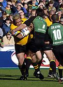 Northampton, Northamptonshire, 2nd October 2004 Northampton Saints vs London Wasps, Zurich Premiership Rugby, Franklyn Gardens, [Mandatory Credit: Peter Spurrier/Intersport Images],<br /> WAsps Trevor Leota [left] run's into the tackle of Corne Krige.