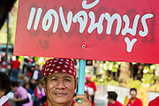 08 MAY 2013 - BANGKOK, THAILAND:   A Thai Red Shirt during a protest at the Constitutional Court. A splinter group of the Red Shirts, Thai supporters of exiled Prime Minister Thaksin Shinawatra, have besieged the Thai Constitutional Court for the last three weeks calling for the resignation of the justices, who have indicated they might oppose a proposed constitutional reform which would grant amnesty to people convicted of political crimes since 2007. This would probably include Thaksin. The justices have refused to step down. Wednesday the protesters moved their protest to the Thai Parliament, which is largely powerless to intervene. PHOTO BY JACK KURTZ
