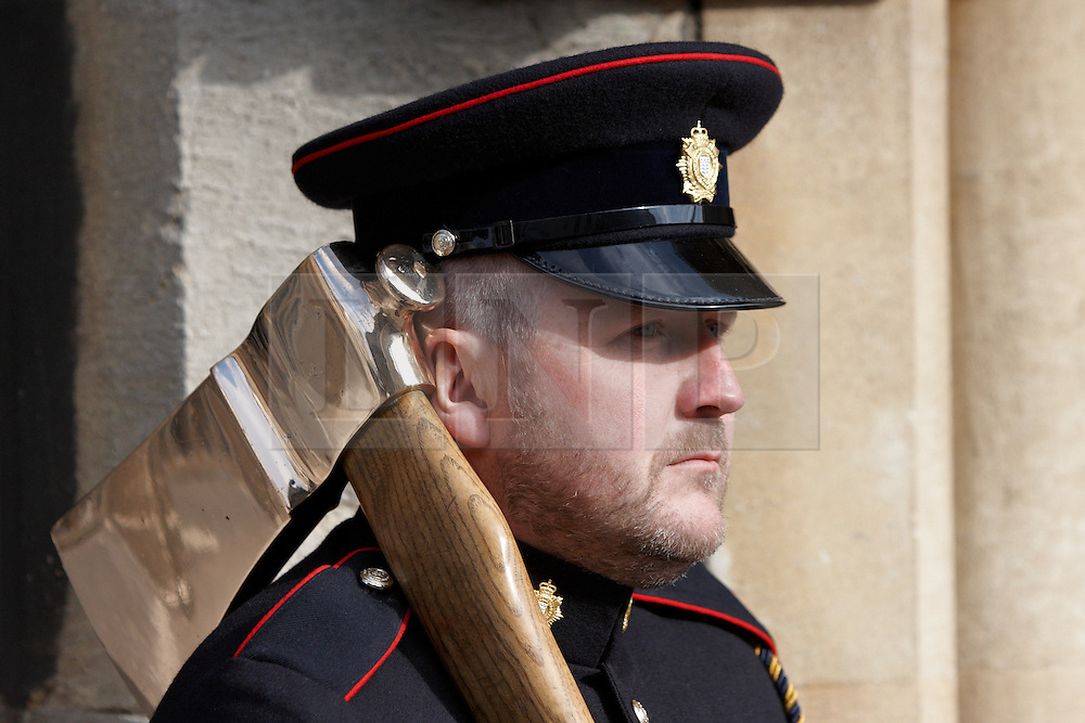 © Licensed to London News Pictures.  04/04/2012. OXFORD, UK. A solider from 23 Pioneer Regiment stands with a ceremonial axe as the regiment marches through the centre of Oxford. The troops have recently returned from Afghanistan are in Oxford due to redevelopment work and road closures in Bicester town centre, which prevents their regular homecoming ceremony from taking place. Photo credit :  Cliff Hide/LNP