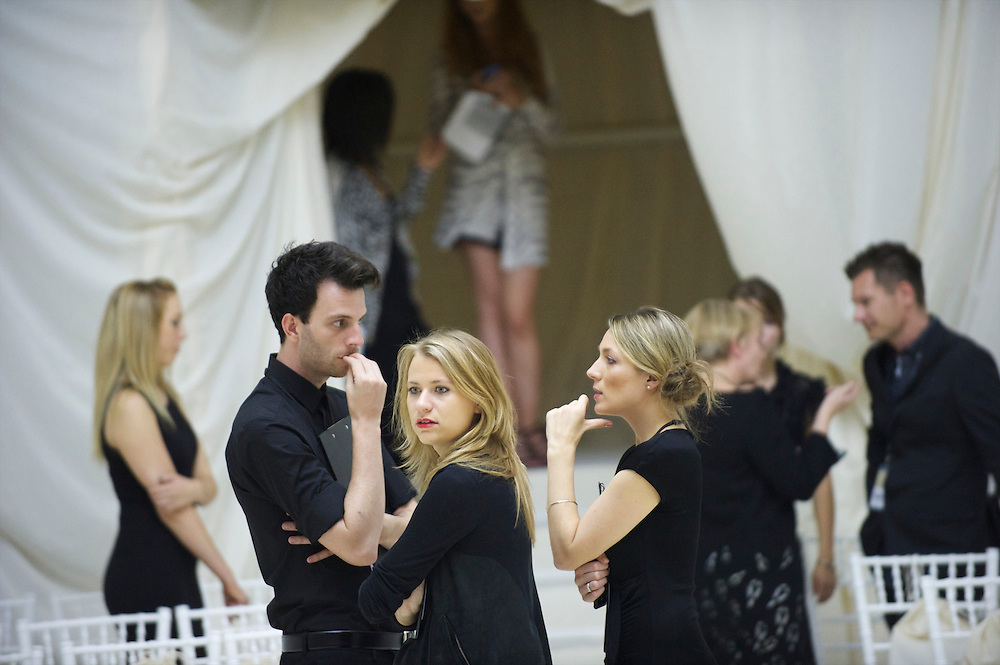 Producers, publicists and assistants make final preparations for the Sass & Bide spring 2011 collection at a specially constructed exhibition space at the Royal Opera House, Convent Garden, London on 17 September 2010.